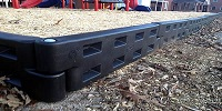 black playground border or plastic border timber